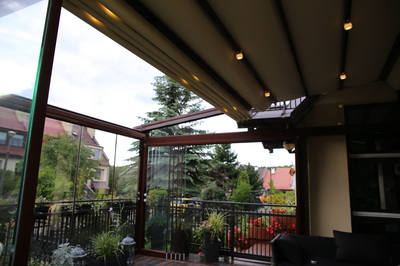 The Porolet® awning roman style canopies ride smoothly overhead in special tracks that are formed into both sides of the vinyl beams.