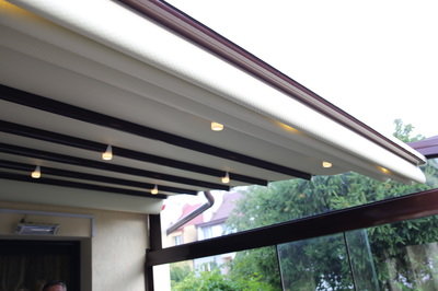 If you prefer vinyl awnings with the look of solid wood, but don't want the hassle of painting, staining or weather-sealing, you'll love  The POROLET awning.